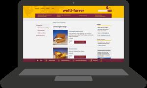 Bild eines Laptops wo www.welti-furrer.ch aufgeschaltet ist.